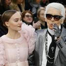 Lily-Rose Depp models with German fashion designer Karl Lagerfeld. (AP/Francois Mori)