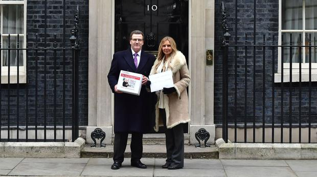 Carol Vorderman and John Nichol deliver the petition