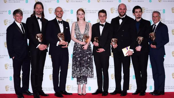 Emma Stone (centre left) and director Damien Chazelle (second from right) with members of the La La Land production team