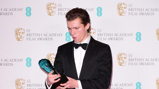 Tom Holland with the award for rising star