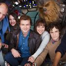 (left to right) Director Christopher Miller, Woody Harrelson, Phoebe Waller-Bridge, Alden Ehrenreich, Emilia Clarke, Joonas Suotamo as Chewbacca, director Phil Lord and Donald Glover, on the set of the new Han Solo Star Wars spin-off (Walt Disney Studios)