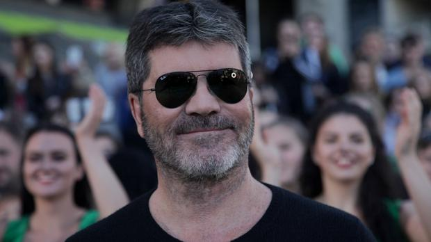 At the time of the break-in, Simon Cowell was in the master bedroom of the house in Holland Park