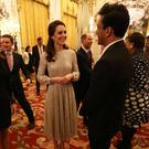 The Duchess of Cambridge speaks to chef Vikas Khanna at Buckingham Palace