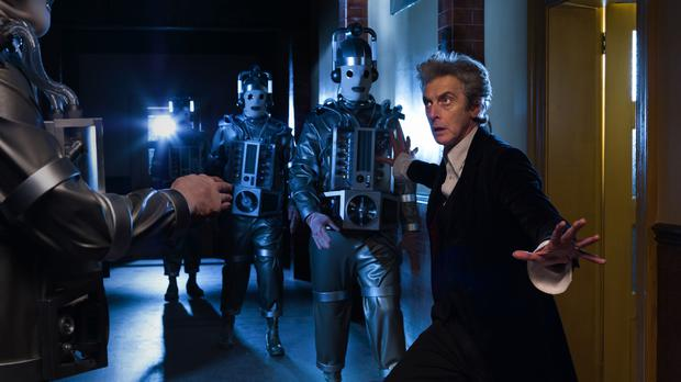 Peter Capaldi as The Doctor with Mondasian Cybermen (BBC/PA)