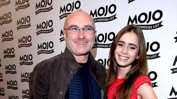 Phil Collins with his daughter Lily, who says she has forgiven her famous father for