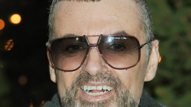 Singer George Michael who died of natural causes.