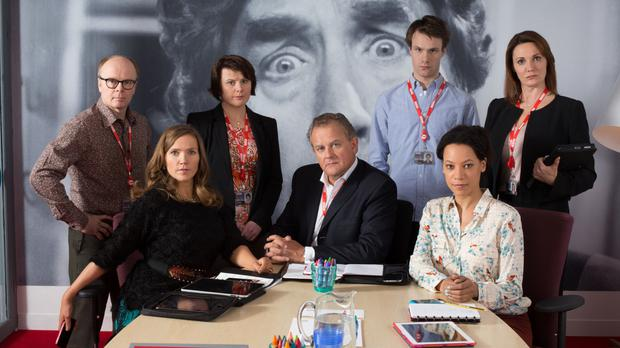 The cast of W1A, in which Hugh Bonneville (centre) stars as Ian Fletcher, the BBC's head of values (BBC/PA)