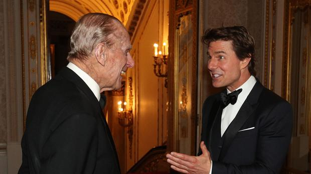 The Duke of Edinburgh meets Tom Cruise during a dinner at Buckingham Palace to mark the 75th anniversary of the Outward Bound Trust