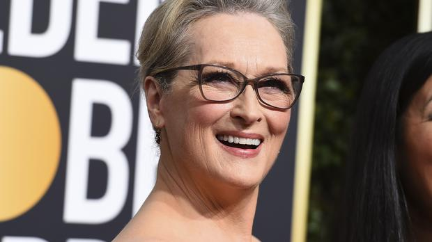 Meryl Streep arrives at the 75th annual Golden Globe Awards (Jordan Strauss/Invision/AP)