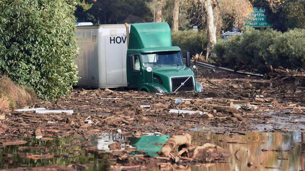 A lorry sits stuck in mud on Highway 101 in Montecito (Mike Eliason/Santa Barbara County Fire Department/AP)
