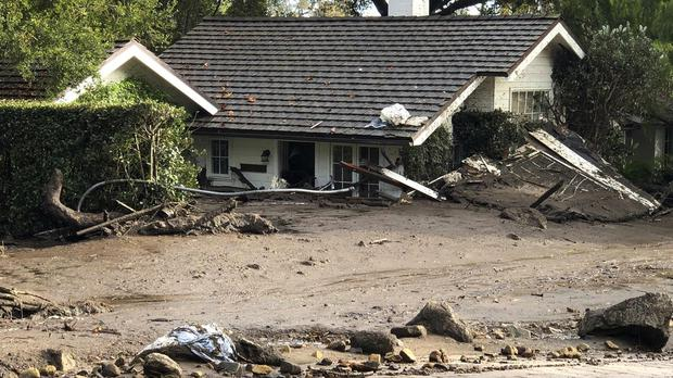 A home buried in flood debris in Montecito, California (Mike Eliason/Santa Barbara County Fire Department via AP)