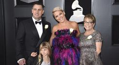 Carey Hart, from left, Willow Sage Hart, Pink and her mother Judith Moore (Evan Agostini/Invision/AP)