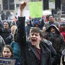 John Collins, 19, a University of Cincinnati student, cheers during the March For Our Lives protest (John Minchillo/AP)