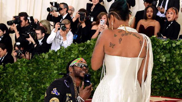 2 Chainz proposes on the red carpet at the Met Gala (PA)