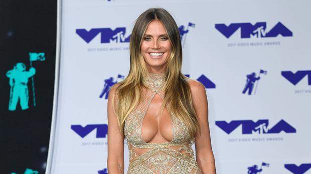 Model Heidi Klum has been photographed for a book celebrating 90 years of Mickey Mouse.