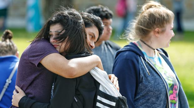 Devastated students embrace following a shooting at Santa Fe High School in Santa Fe, Texas. (Michael Ciaglo/Houston Chronicle via AP)