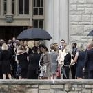 Mourners gather outside the church in Kansas City (Orlin Wagner/AP)
