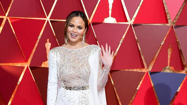 Chrissy Teigen gave birth to Miles in May (Ian West/PA)