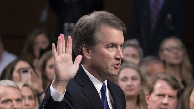 Celebrities including Jane Fonda and Mandy Moore have joined calls for Donald Trump's Supreme Court nominee Brett Kavanaugh to step aside (J Scott Applewhite/AP)