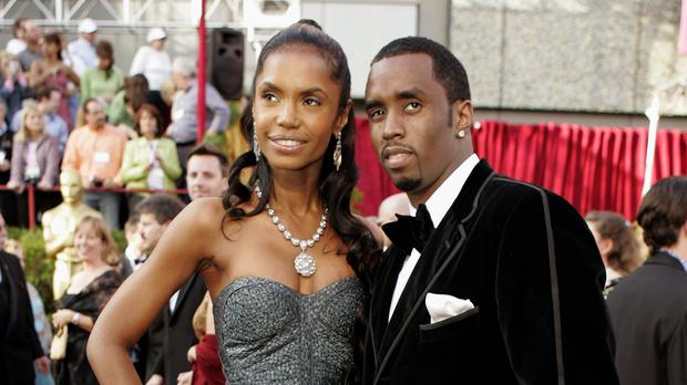 "Sean ""Diddy"" Combs arrives with Kim Porter, for the 77th Academy Awards in Los Angeles (Amy Sancetta/AP)"