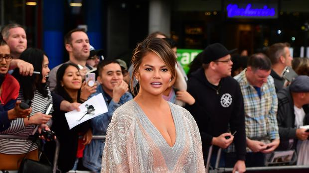 Chrissy Teigen revealed her son Miles Theodore requires a helmet to adjust a 'slightly misshapen head' (Ian West/PA)