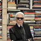 Karl Lagerfeld poses for photographers in front of his books (Martin Meissner/AP)