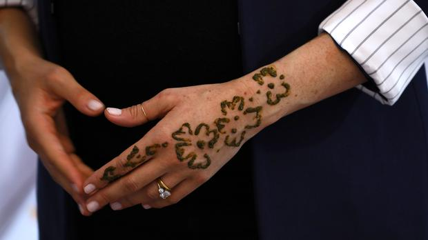 204b156cb3fa7 Duchess of Sussex gets henna tattoo in Moroccan custom to celebrate ...