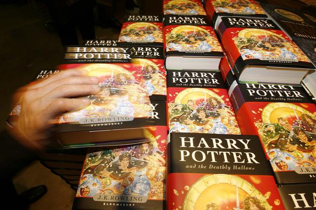 Harry Potter fans grabbing copies of a book (Ben Stansall/AP)