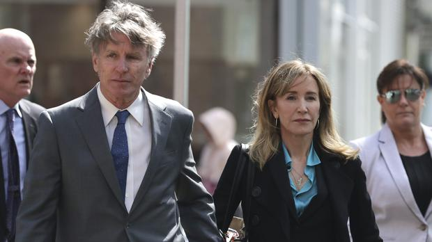 Actress Felicity Huffman arrives at court holding hands with her brother Moore Huffman Jr to face charges in a nationwide college admissions bribery scandal (AP Photo/Charles Krupa)