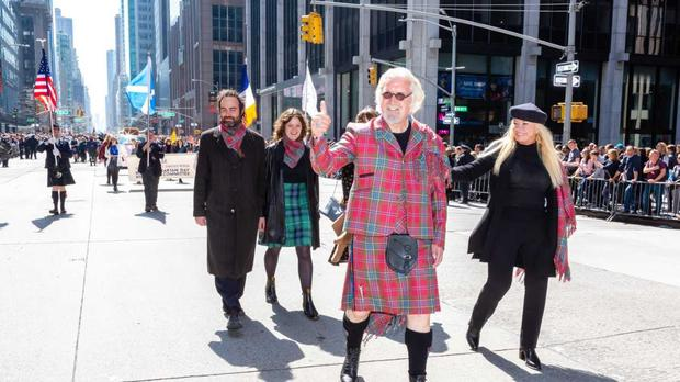 Sir Billy Connolly led the New York Tartan Day Parade as Grand Marshall, joined by family including wife Pamela (right) (Benjamin Chateauvert/New York Tartan Day/PA)