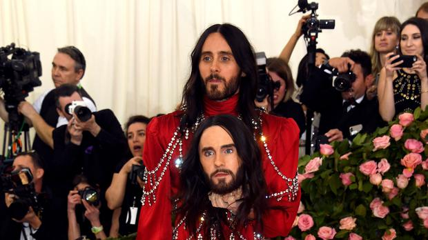 Actor Jared Leto once again made waves at the Met Gala, this time by walking the pink carpet while carrying a model of his head (Jennifer Graylock/PA)