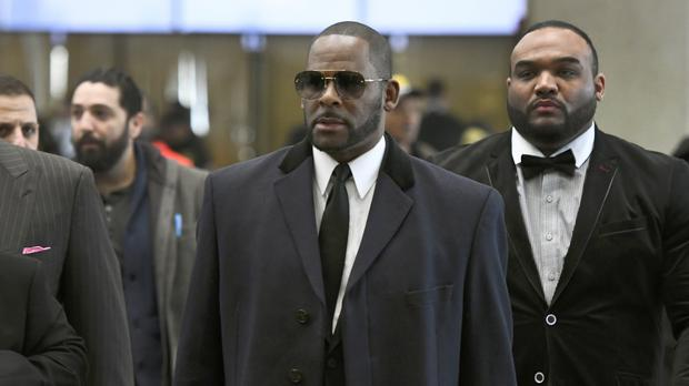 Musician R. Kelly, centre, arrives for a court hearing in Chicago (Matt Marton/AP)