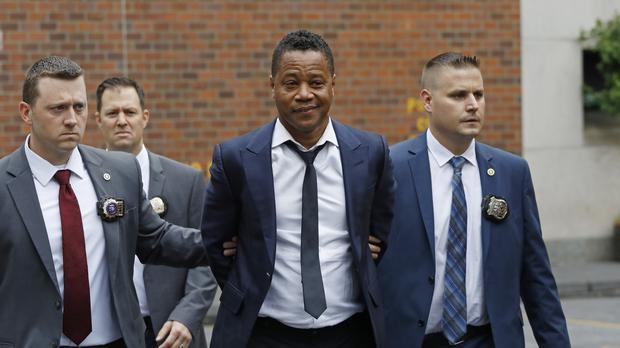 Actor Cuba Gooding Jr being led by police officers in New York (Mark Lennihan/AP)