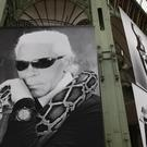 A photograph of late German fashion designer Karl Lagerfeld is displayed (Francois Mori/AP)
