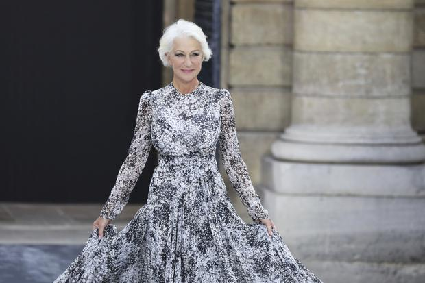 Actress Dame Helen Mirren wore a flowing gown for her turn on the catwalk (Vianney Le Caer/Invision/AP)