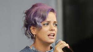 Lily Allen has threatened English Defence League co-founder Tommy Robinson with legal action