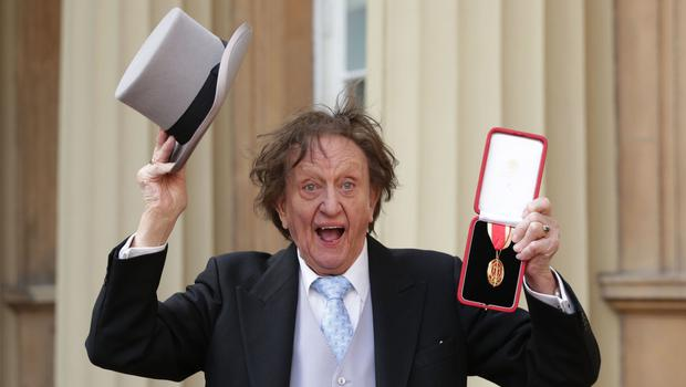 Veteran entertainer Sir Ken Dodd at Buckingham Palace after he was made a Knight Bachelor of the British Empire by the Duke of Cambridge