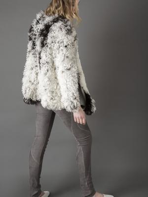 Two-tone lambskin cape (one-off piece), €1,950; stretch-suede leggings with detailing, €850