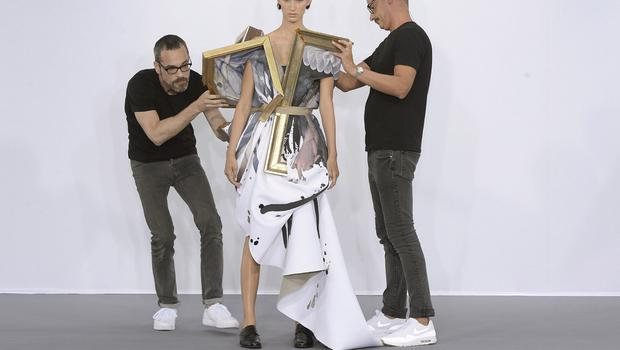 The art of fashion:  Viktor & Rolf Autumn 2015 couture show saw the designers dismantle their artwork-themed dresses on the catwalk
