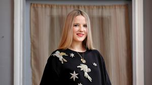 Sorcha O'Raghallaigh wears her jewelled moon sweatshirt (€550) with ostrich feather skirt (€950) and Zodiac medallions
