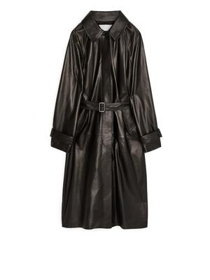 Leather trench, €590, Arket