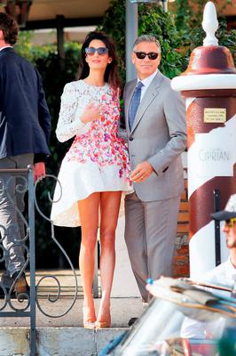 Amal Clooney, who has sensational pins, with her husband George Clooney