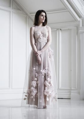 Lavender nude corseted tulle and silk  gown with hand cut organza and leaf embroidery, tulle removable shoulder piece, €2,650.