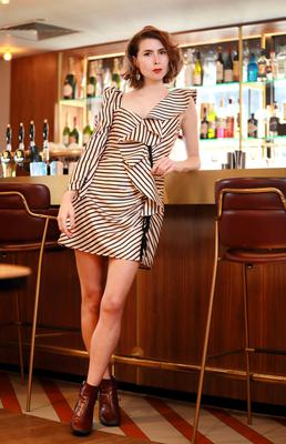 Sophie Donaldson in her Borrower Boutique striped mini dress. Photo: Frank Mc Grath