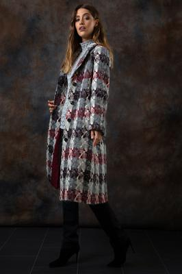 'Alexa' tweed coat with St Brigid's Cross design, €875, from Magee 1866, available at its store on South Anne Street, Dublin, and at Arnotts, Henry Street