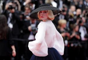 The big cover up: Elle Fanning at the Cannes Film Festival last month