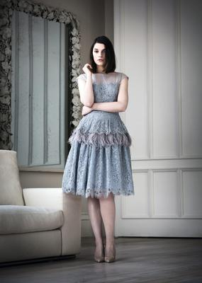 Powder blue Calais lace and smoke grey organza dress with hand dyed ostrich feathers at hip and silk organza and tulle shoulders, €2,200. Nude patent stiletto shoes, €540, Manolo Blahnik at Shoe rooms,  Brown Thomas