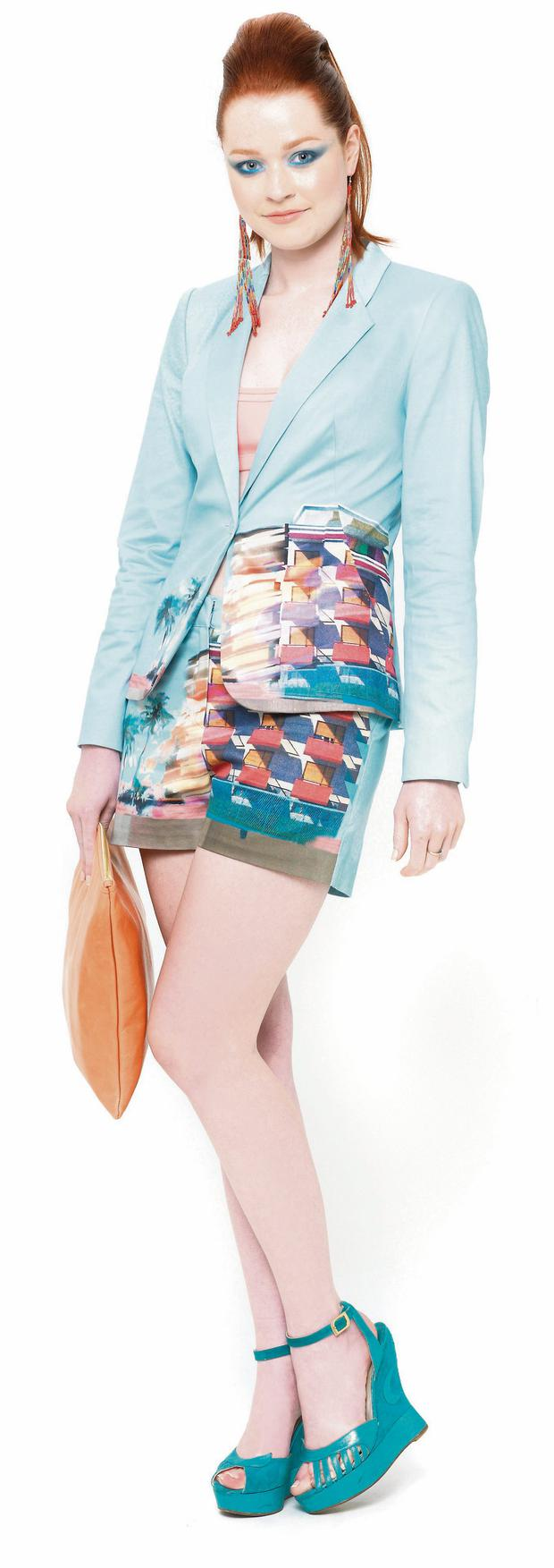Lauren wears beaded tribal earrings, €18, River Island; 'Miami' print blazer, €250, and shorts, €110, both Ted Baker, Grafton Street, and Brown Thomas; chiffon cami, €30, and peach leather clutch, €56, both American Apparel, and Terry de Havilland wedges, reduced to €250 to buy, Couture For Hire, Duke Street, D2