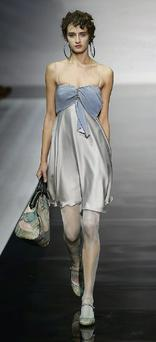 A model presents the latest collection from Emporio Armani at Milan fashion week