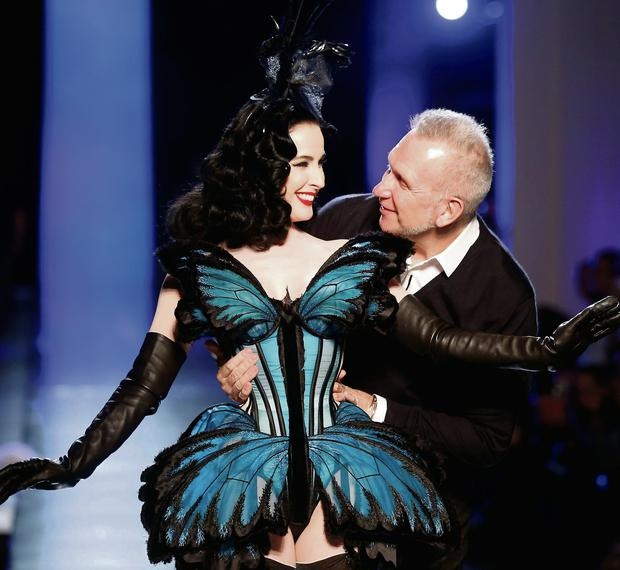 French designer Jean-Paul Gaultier and burlesque star Dita Von Teese appear at the end of his Haute Couture Spring/Summer 2014 fashion show in Paris